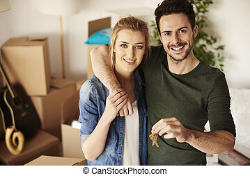 Loving couple with keys to new home