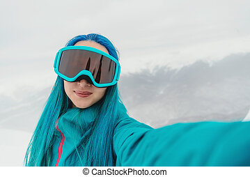 Snowboarder doing selfie, pov - Smiling young woman...