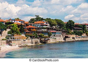 Coastal view of Nesebar city houses and embankment. Nesebar...