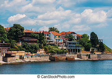 Coastal view of Nesebar city houses and embankment. Nesebar...