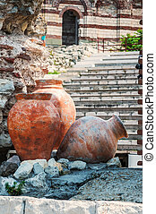 Ancient amphoras near Ruined Church of Christ Pantocrator in...
