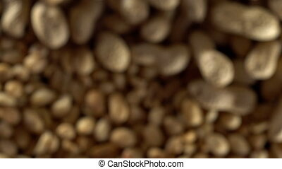 Close up of shelled peanuts rotating. Out of focus. - Close...