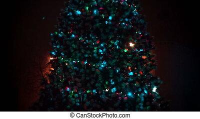 Christmas tree at night - elegant bright flickering...
