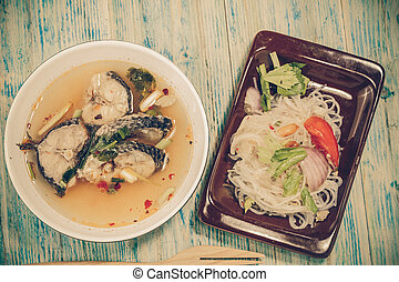 Spicy TOM YAM fish soup with lemongrass, chilly pasted and...
