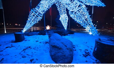 Abstract snowflake illumination. - Christmas festive street...