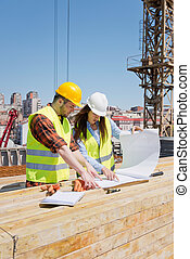 Architect with construction worker