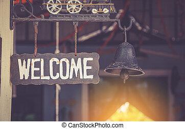 grung metal welcome sign hanging. selective focus.