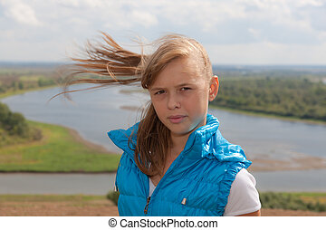 girl in windy day - Portrait of the young girl in windy day