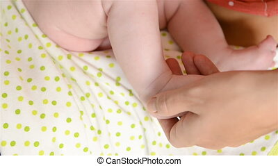 massage newborn baby - Mother doing preventive massage her...