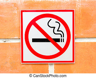 non smoking sign on brick wall