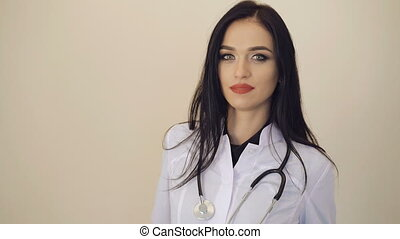 Portrait of pretty confident female doctor looking to camera