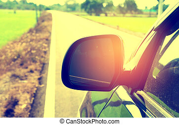 side view mirror car on country road , vintage