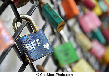 Best friend forever padlocks locked on iron chain - Best...
