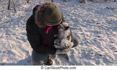 Man with small dog in cold day