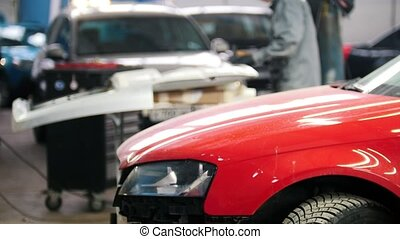 Defocused background - professional car service - man work...
