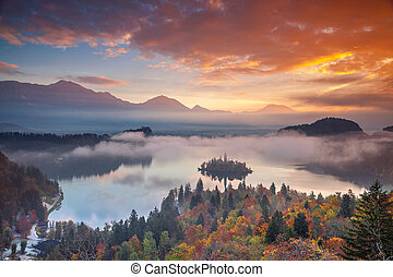 Lake Bled in Autumn. - Lake Bled with St. Marys Church of...