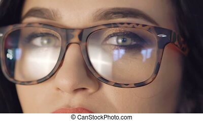Close up strong look of pretty girl's eyes in glasses. Full...