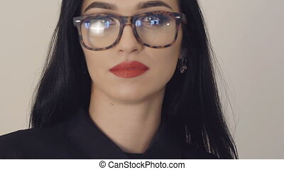 Portrait of passionate girl in glasses with big eyes and red...