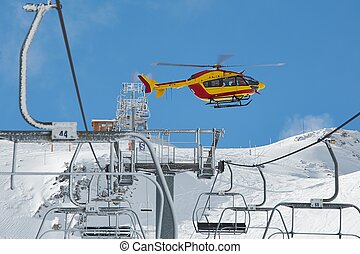 Rescue helicopter in the mountains - Rescue helicopter on...