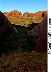 The Olgas. - Huge monolithic blocks of red color in sun...