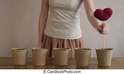 Woman growing hearts