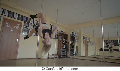 Beautiful young girl Pole dance studio stock footage video -...