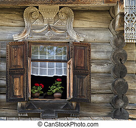 window of old, wooden house in the countryside - window with...