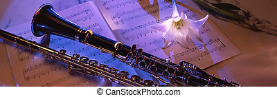 Clarinet on sheet music 2 - clarinet lying on music sheet...