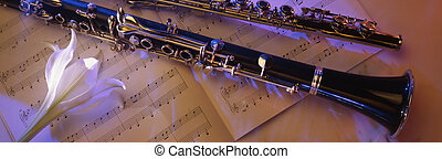 Clarinet on sheet music1 - clarinet in moody lighting...