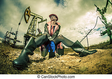 Women worker. Oil and gas industry. - Women worker in the...