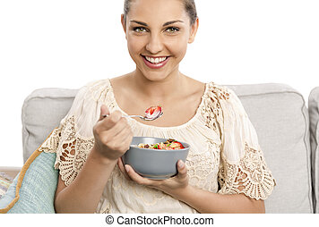 Eating healthy - Beautiful happy woman at home eating a...