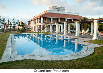 Bungalow - A colonial bungalow with a swimming pool.