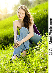 beautiful teen girl on meadow smile