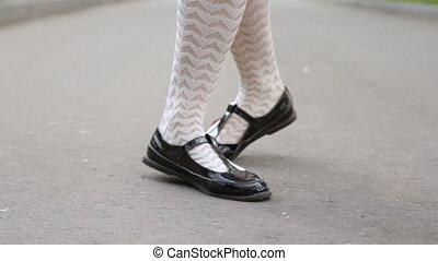 Dancer's legs close-up. Girl dancing solo jazz swing dance...