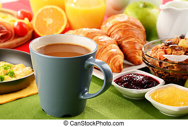 Breakfast served with coffee, juice, egg, and rolls -...