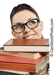 student with glasses behind books - pretty student with big...