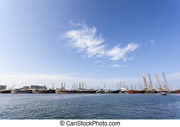 Dhow harbor in Sharjah, UAE - Dhow harbor and docks at the...