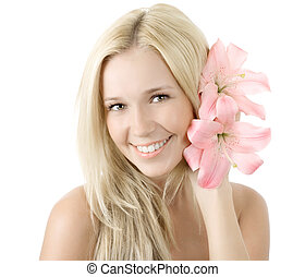 Beautiful young blonde woman with lily flower smile isolated