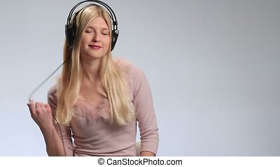 Blond sexy woman posing with headphones