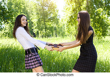 two student girl taken one same book outdoor