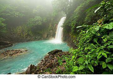 Rio celeste waterfall at foggy day Tenorio national park...