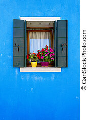 Burano island, Venice, Italy - Picturesque windows on the...