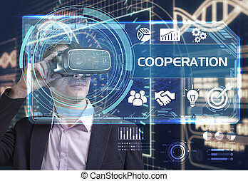 Business, Technology, Internet and network concept. Young businessman working in virtual reality glasses sees the inscription: cooperation