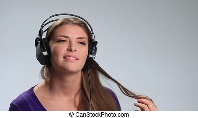 Cute girl relaxing listening music with headphones -...