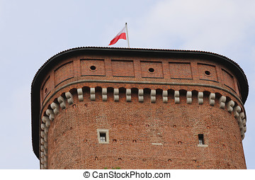 tower and flag of Wawel Castle in Poland - tower and flag of...