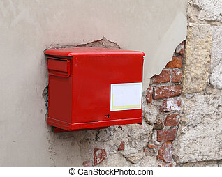 red mailbox on the peeling wall - old red mailbox on the...