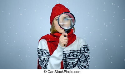 Searching winter woman. Girl wearing warm winter clothes...