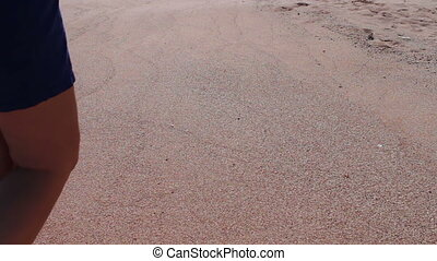 girl feet leave footprints on the beach - Beautiful slim...