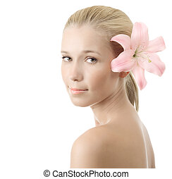 Beautiful young woman with pink lily isolated on white