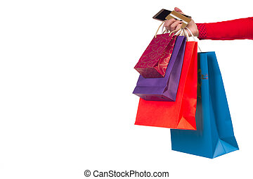 Woman hand holding shopping paper bags, packages, banking credit card